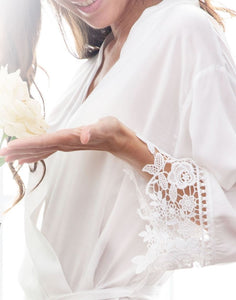 A closeup image of the Dafne Robe in White Diamond. The image shows the floral lace detail of the sleeve cuff which is delicate and ever so elegant.