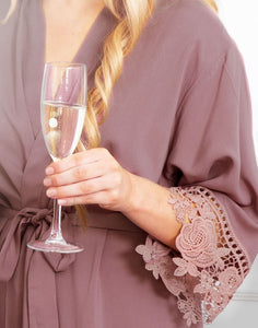 A closeup image of the Dafne Rosewood Mauve Robe. This image shows the delicate floral lace trim on the sleeve.