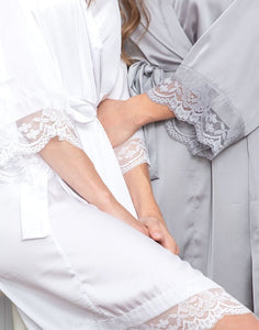 A closeup image, of the Grey Moonstone Dorotea robes sleeve. This shows the delicate lace detailing of the sleeve which is elegant make makes this robe a timeless beautiful piece.