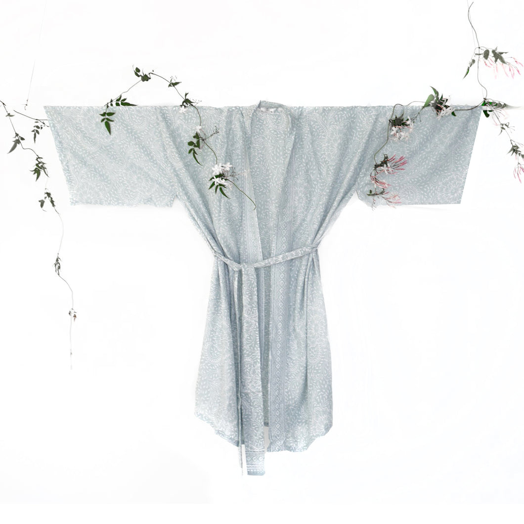 An image of a bridal party kimono wedding robe. The dusky grey colour is subtle and timeless. The image shows the kimono style design and matching robe tie.