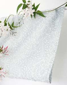 An image of a bridal party kimono wedding robe. The dusky grey colour is subtle and timeless. The close up image shows the fabric peony pattern design and sleeve detail.
