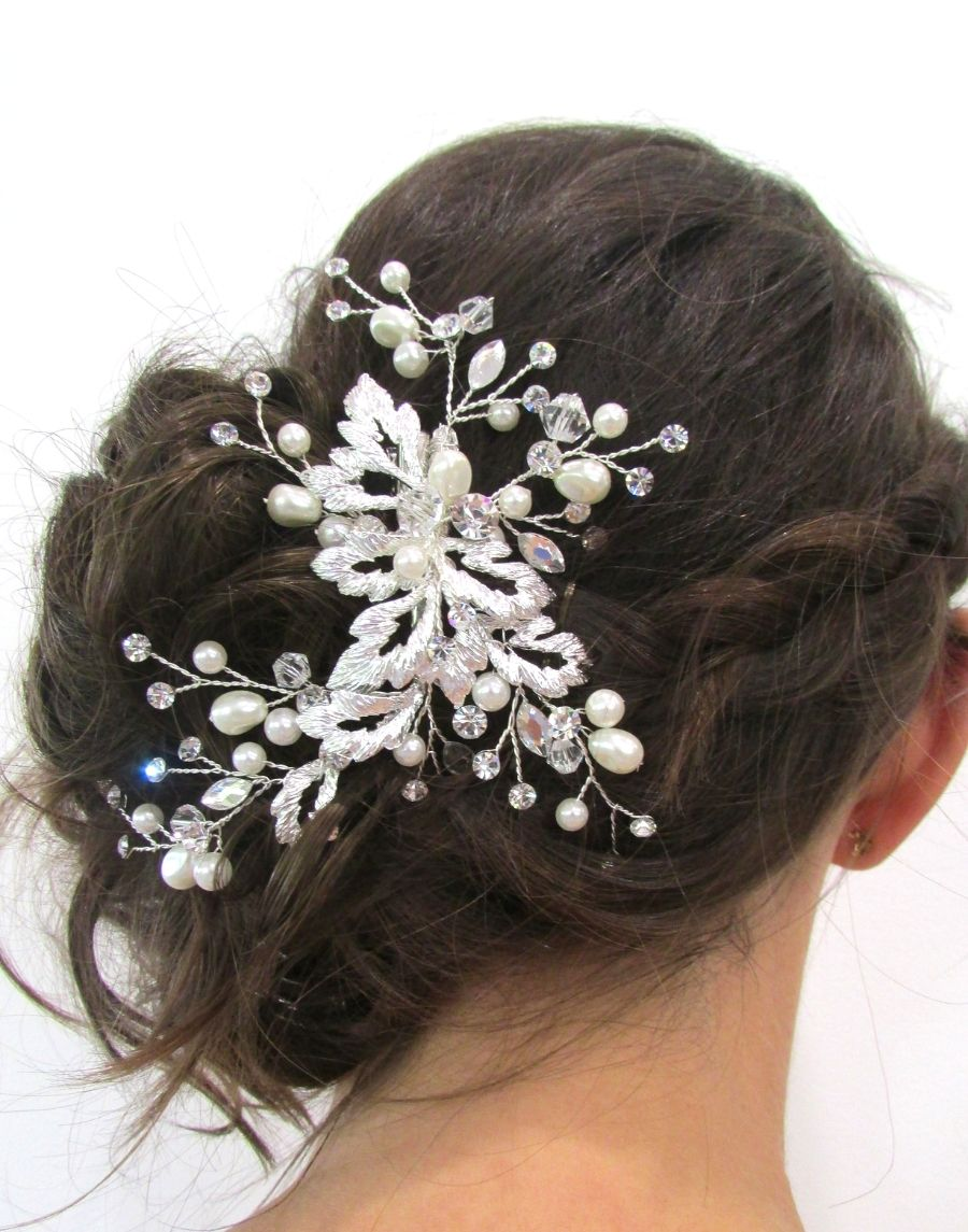 An image of the Lolita Bridal Clip Hairpiece showing the glass, Swarovski crystal & clear pearlescent beading bridal hair clip. It is placed on a brunette low side bun up-do hairstyle. The moveable stems show how this piece can be truely shaped to your hair style.