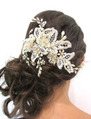 Load image into Gallery viewer, An image of the Maria Bridal Comb Hairpiece showing the glass, Swarovski & pearl detailed Bridal Comb placed in a brunette curled low updo hairstyle.