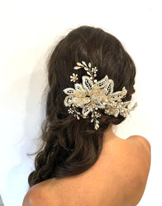 An image of the Maria Bridal Comb Hairpiece showing the glass, Swarovski & pearl detailed Bridal Comb placed in a brunette curled low side-do hairstyle.
