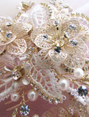 Load image into Gallery viewer, A closeup image of the Maria Bridal Comb Hairpiece showing it's glass, Swarovski & pearl detailing on gold-toned wiring.