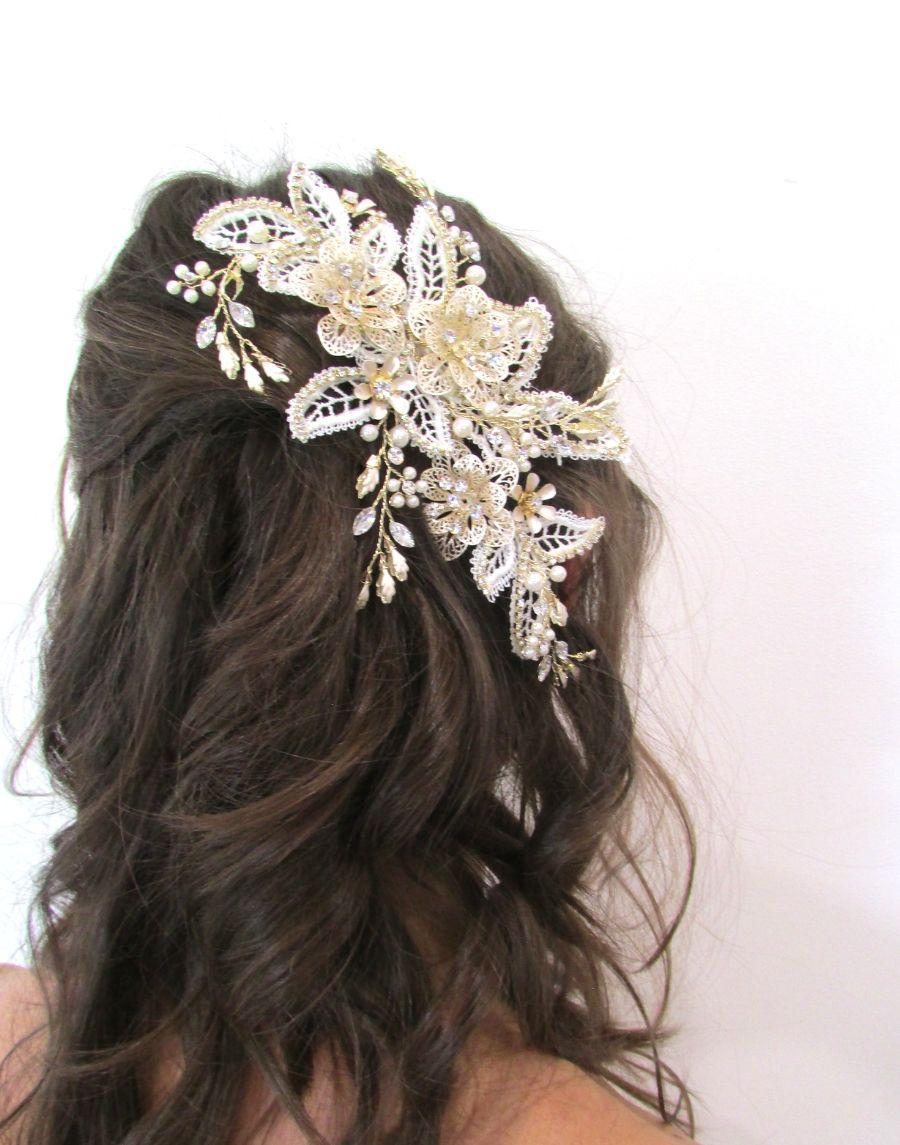 An image of the Maria Bridal Comb Hairpiece showing the glass, Swarovski & pearl detailed Bridal Comb placed in a brunette flowing hairstyle.