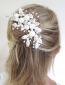 Load image into Gallery viewer, An image of the Pearl Bridal Clip showing the very elegant with Swarovski crystals & lace overlaid pearl design placed in a blonde semi up-do hairstyle.