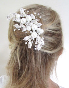 An image of the Pearl Bridal Clip showing the very elegant with Swarovski crystals & lace overlaid pearl design placed in a blonde semi up-do hairstyle.