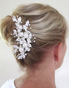 An image of the Pearl Bridal Clip showing the very elegant with Swarovski crystals & lace overlaid pearl design placed in a blonde simple up-do hairstyle.
