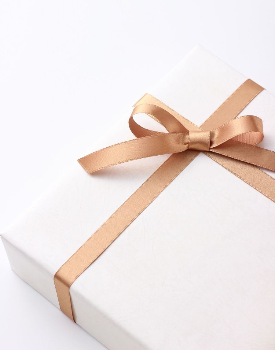 White Wrapped gift with gold bow neat in the top left corner. Gift Wrapping available on all items.