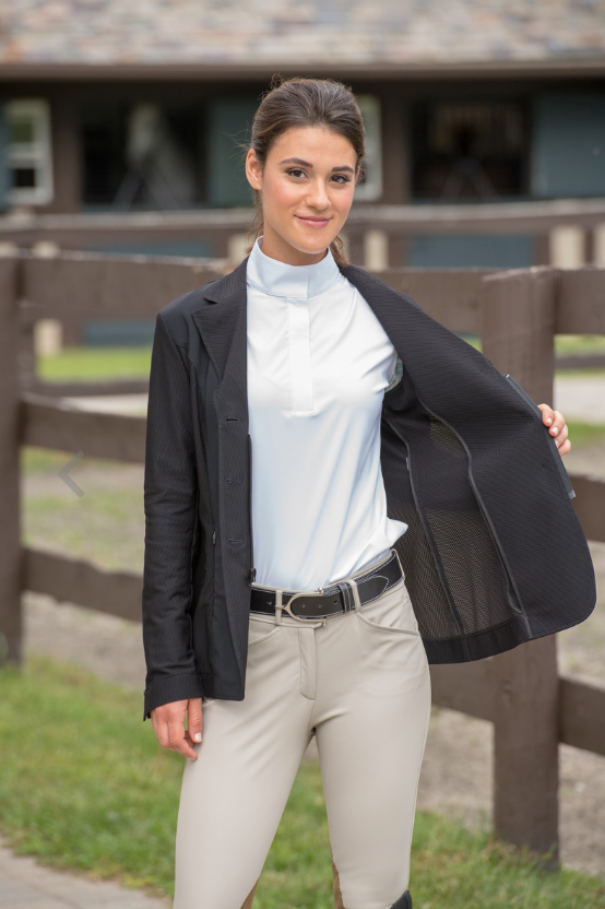 The Harmony show coat with its unique styling offers the rider an elevated, athletic garment while maintaining the tradition of the sport.