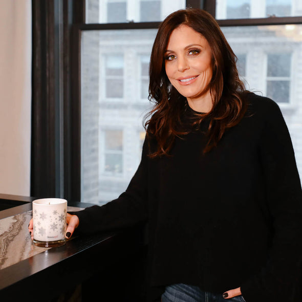 Bethenny Frankel holding a Shop Skinnygirl Luxury scented candle