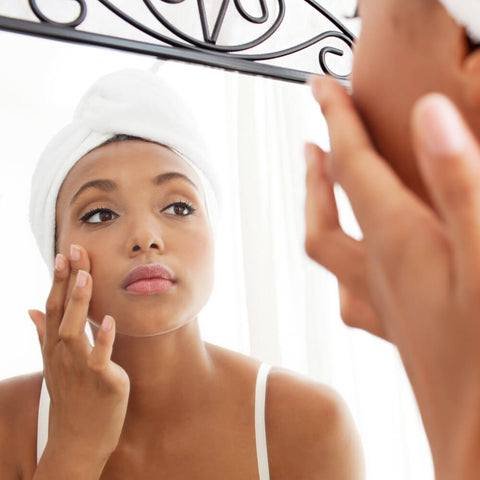 Woman applying Skinnygirl age-defying  serum