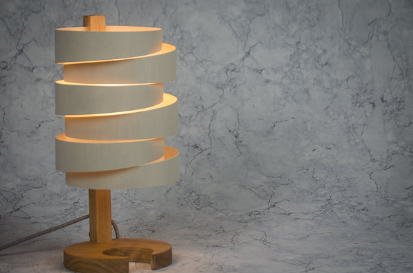 Handcrafted in Devon using sustainable woods, these lamps make great statement pieces for any modern interior. Oak base with bent birch ply & opaque polypropylene shade. These are made to order and take 10-14 days delivered direct to you.      H:40cm Dia:20cm