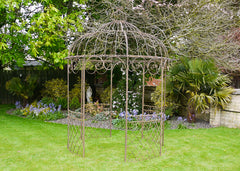 As seen on ITV Love Your Garden with Alan Titchmarsh. We were honoured to be asked to help such a deserving family & was our pleasure to donate to the programme.  Add structure & interest to your garden with one of our vintage gazebos. Made from steel & powder coated in either cream or original. Perfect for growing climbing roses around. Comes in sections for easy assembly.