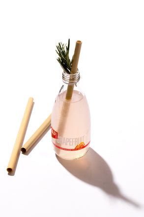bamboo straw in a glass bottle