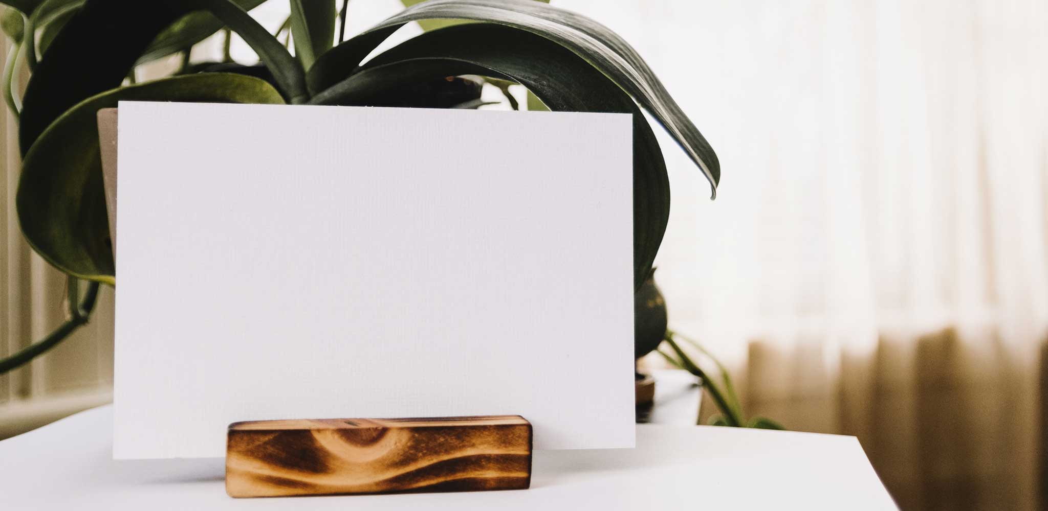 image of a white piece of paper in a wooden stand on a table