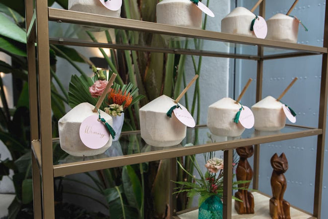 bamboo straws in coconut shells at a wedding