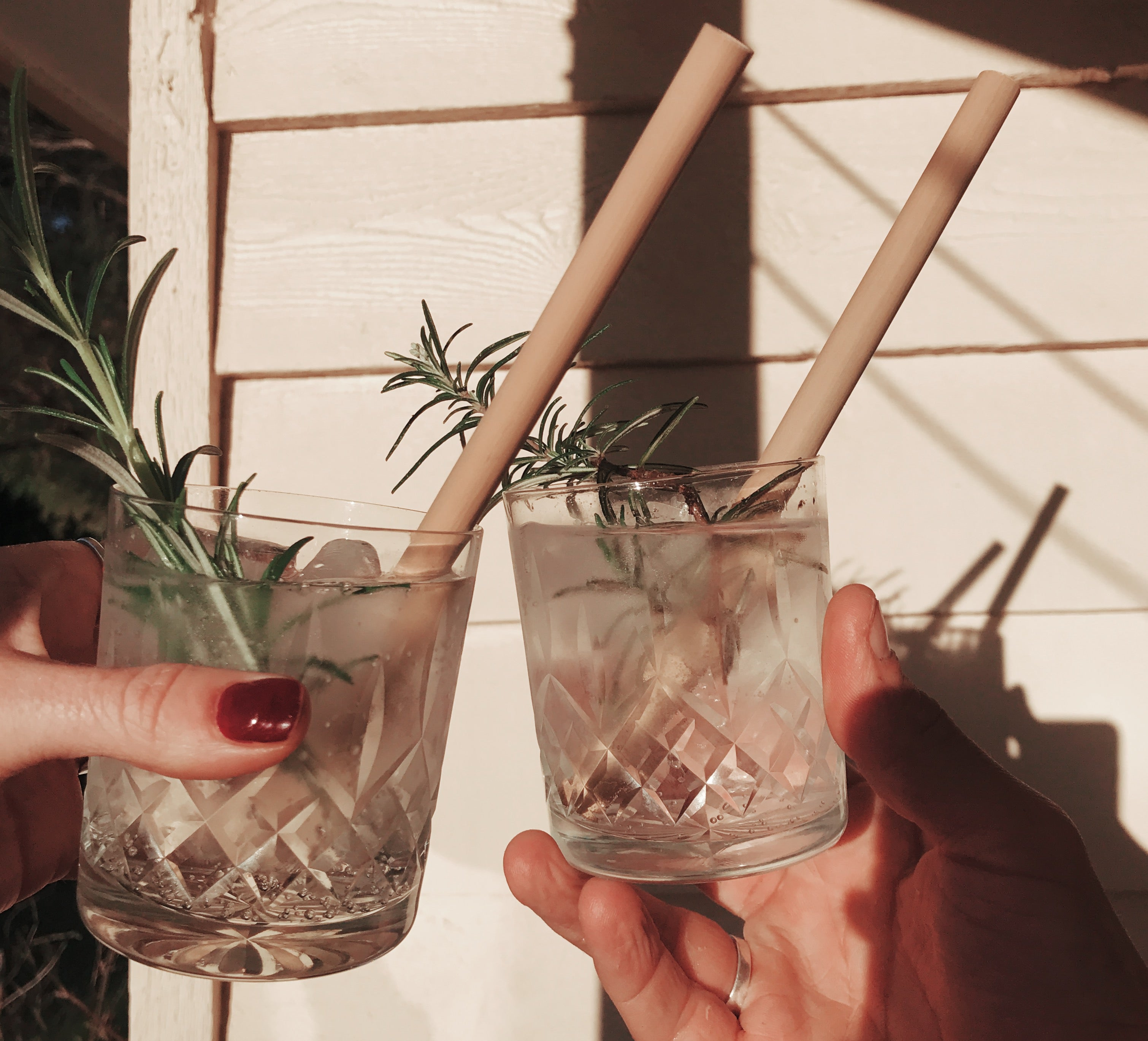 two gin and tonics with bamboo straws
