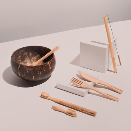 bamboo straws, bamboo cutlery, bamboo toothbrush and coconut bowl