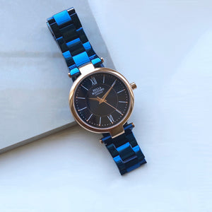 The Signature Solo. Rose Gold Dial and Blue Strap