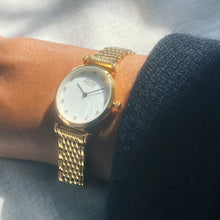 The Kensington. Gold Stainless Steel Strap and Bezel With Pearl Dial