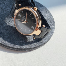 The Signature Solo. Rose Gold Dial And Black Strap