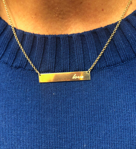 gold necklace love on blue sweater