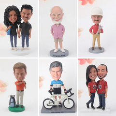 6 bobbleheads, 2 couples, one man golfing, one in a hard hat, one with a bike