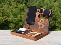 Docking station from Etsy, personalized in dark wood, holds phone, watches, earbuds and wallet