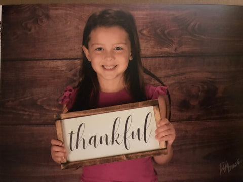 Jillian holding thankful sign in school picture