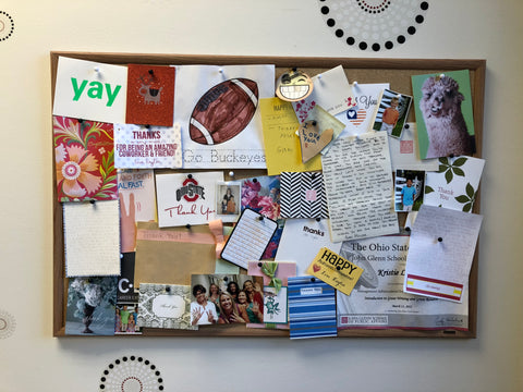 Bulletin board full of thank you notes