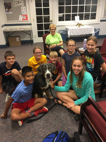 Therapy dog with kids at Spring Creek Church of the Brethren