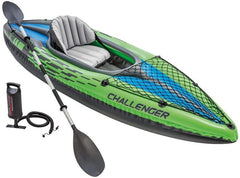 green and blue inflatable kayak with one gray seat, paddle and pump