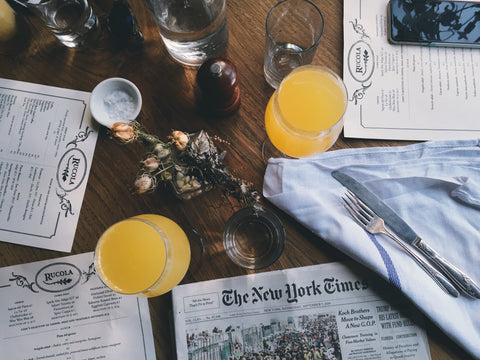 image of newspaper New York Times and juice glasses and menus