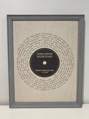 gray framed print on cream linen, lyrics to a song in the shape of a record