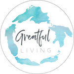 great lakes in a circle with greatful living as the logo