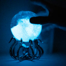 Bio-Orb on  OctoStand at night bioluinescence octopus hand