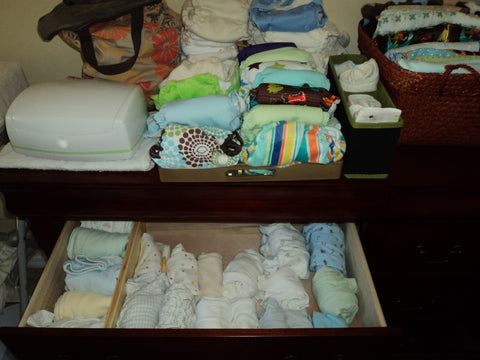 A tray holds cloth diapers while the drawer keeps the most used baby clothing nearby