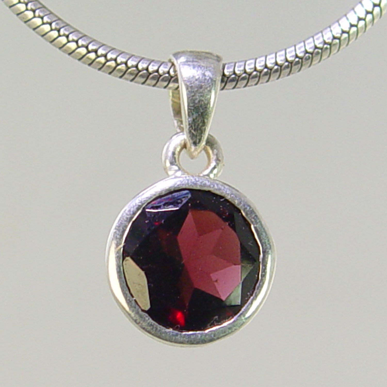 Garnet 4.5 ct Faceted Round Bezel Set Sterling Silver Pendant