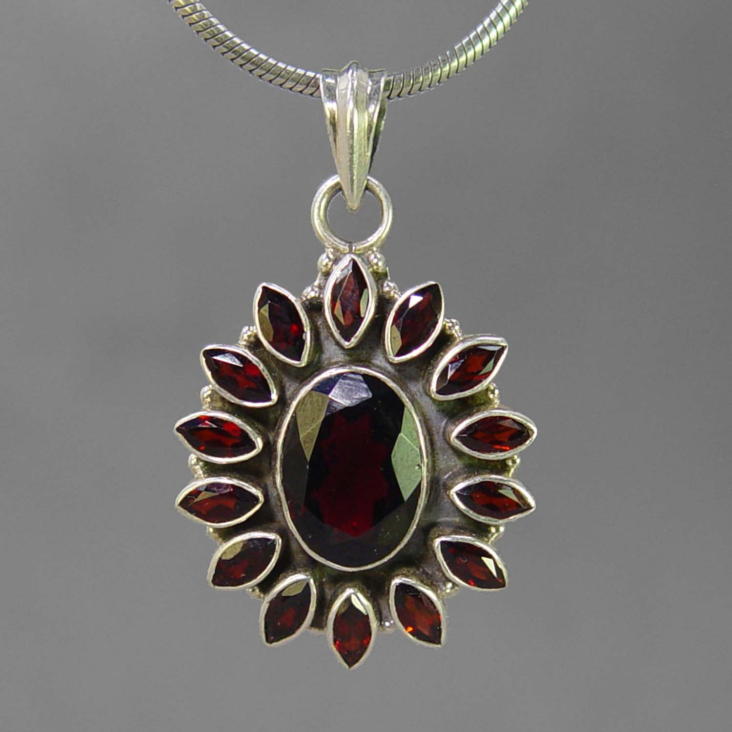 Garnet 8 ct Faceted Oval Sterling Silver Pendant