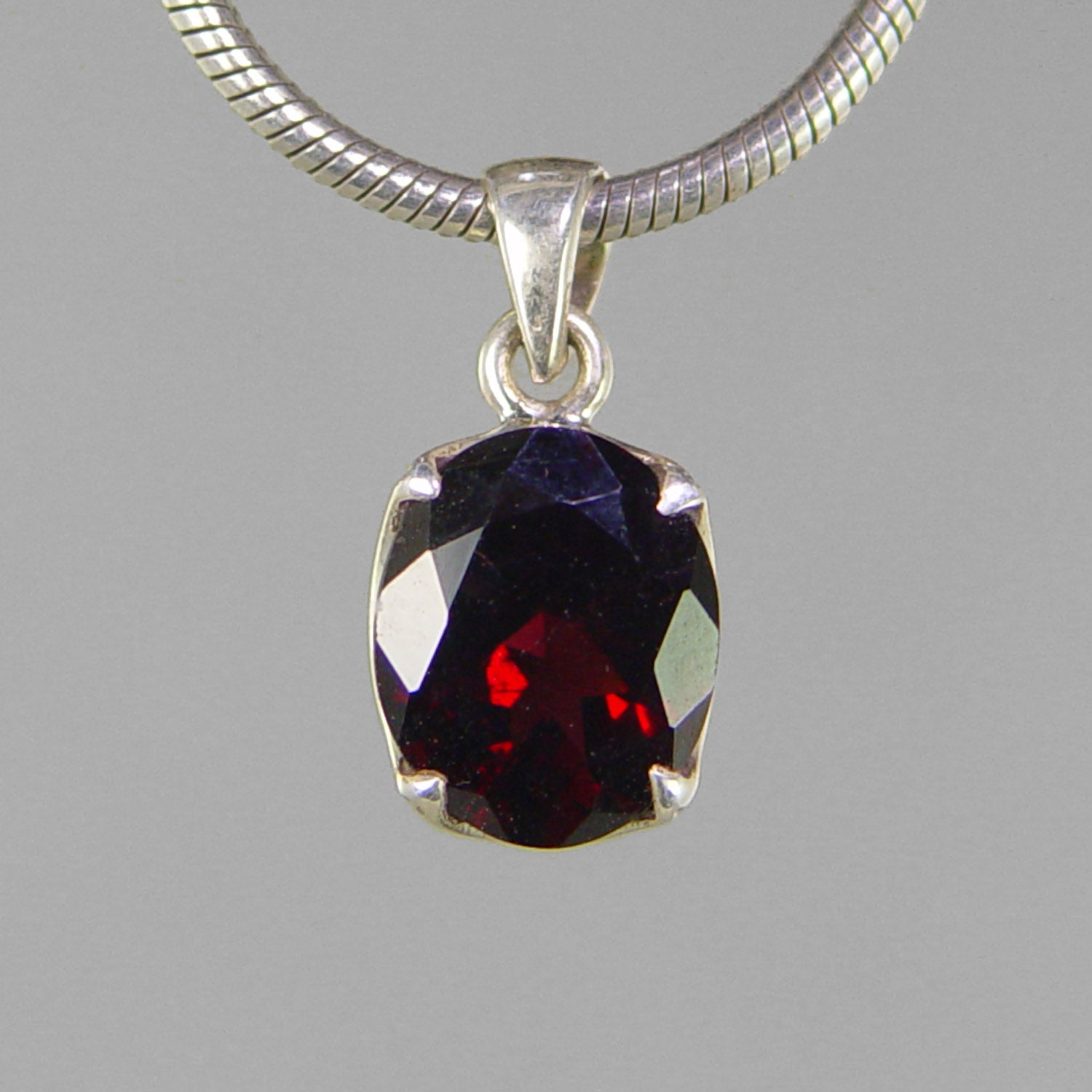 Garnet 5.5 ct Faceted Oval Sterling Silver Pendant