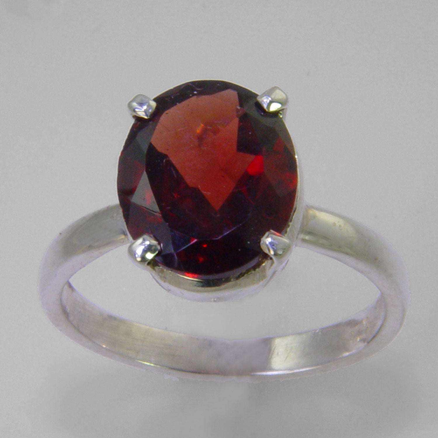 Garnet 2.5 ct Faceted Oval Sterling Silver Ring, Size 7
