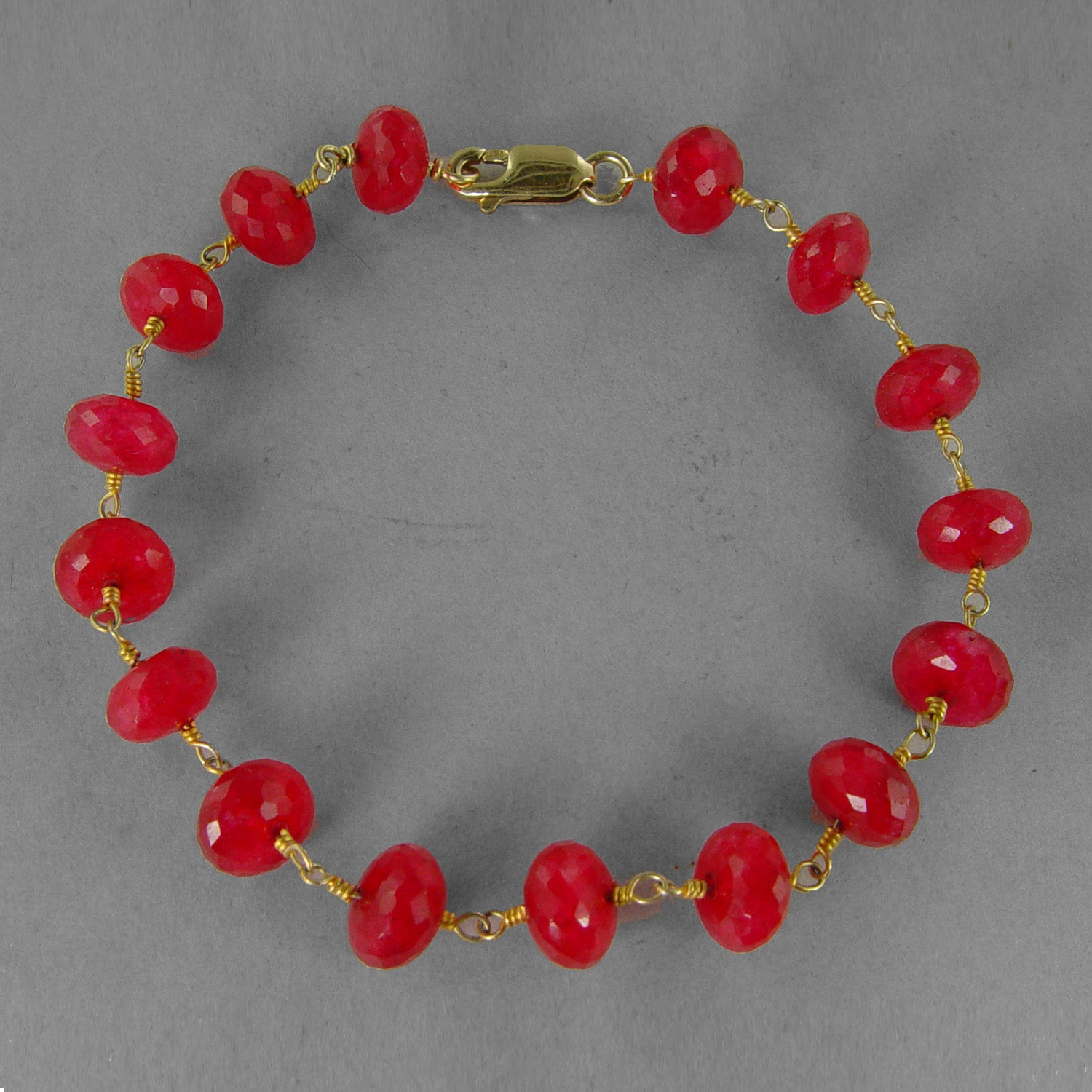 "Ruby Faceted Rondelle Beads on Gold Filled Wire 8"" Bracelet"