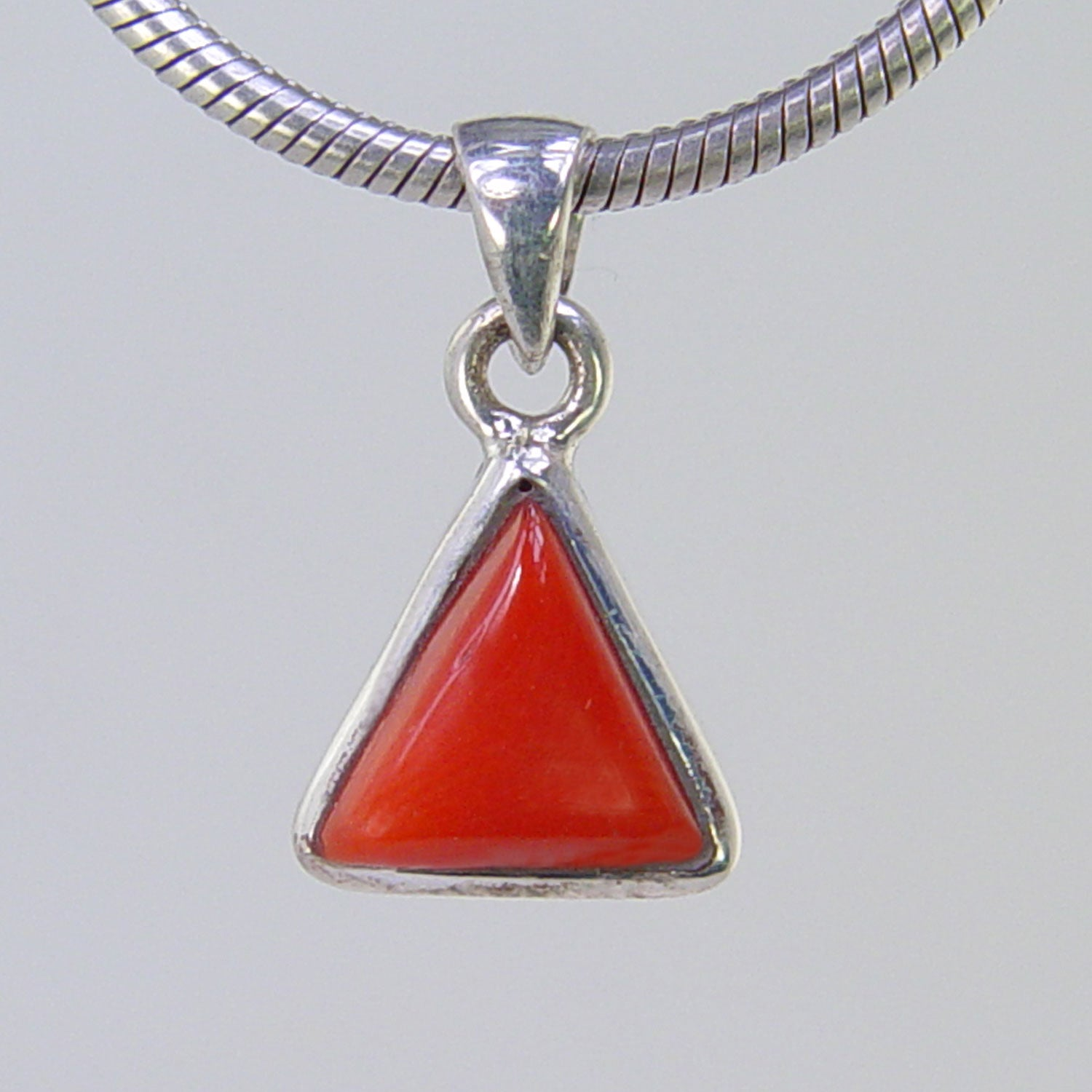Red Coral 2.3 ct Triangle Cab Bezel Set Sterling Silver Pendant