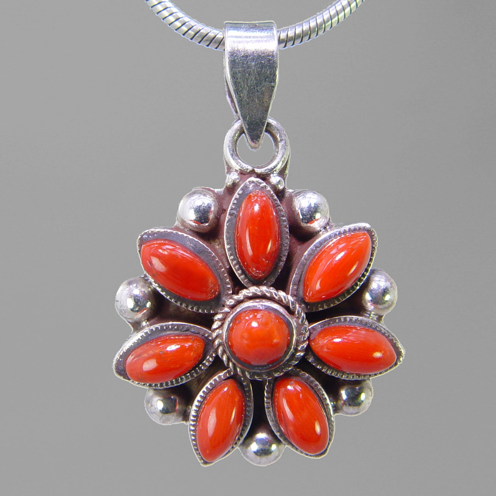 Red Coral 6 ctw Bezel Set With 8 Small Stones Sterling Silver Pendant