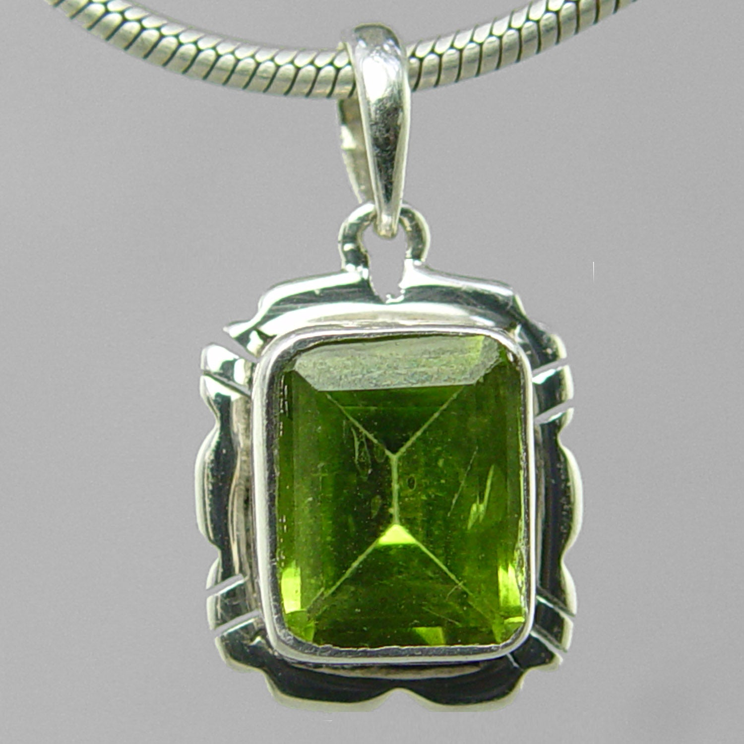 Peridot 3.5 ct Faceted Emerald Cut Bezel Set Sterling Silver Pendant