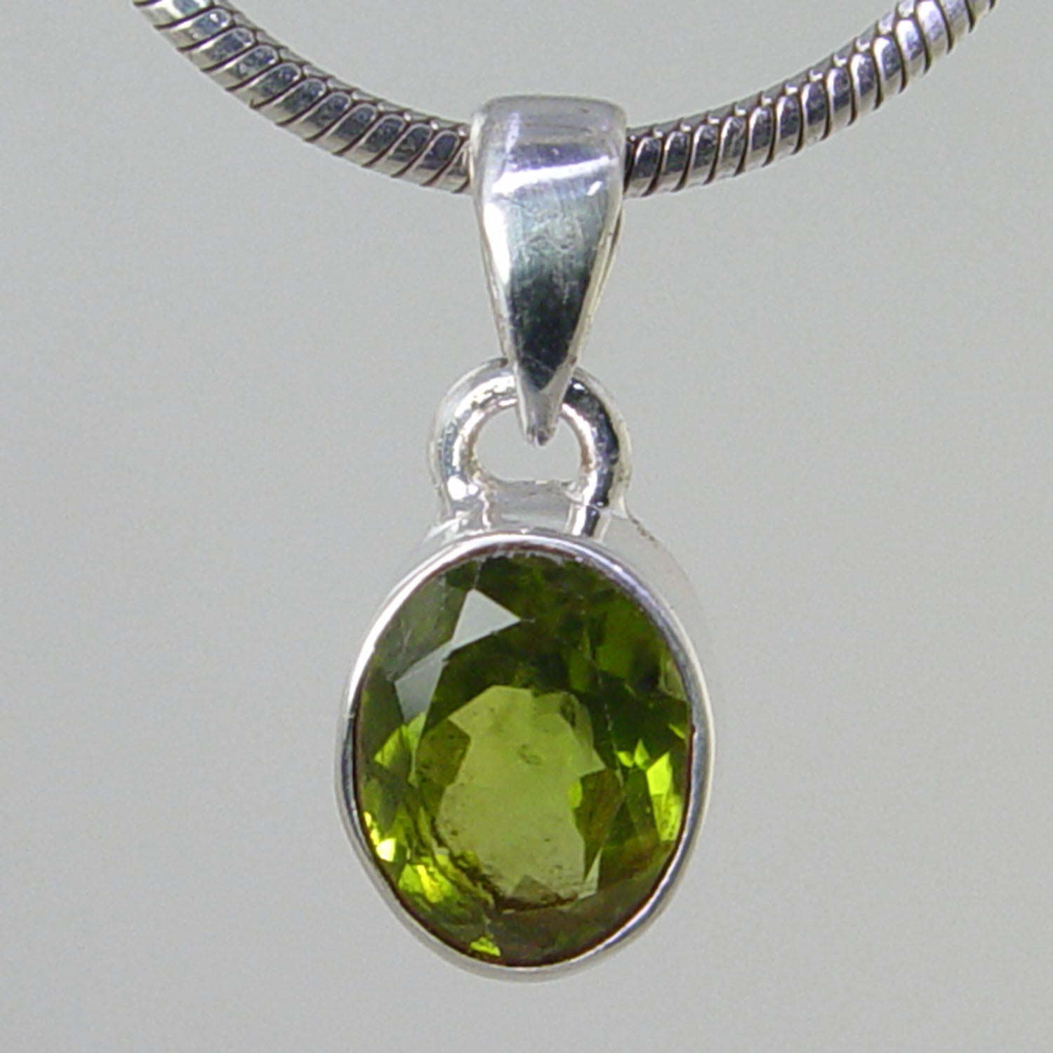 Peridot 3.6 ct Faceted Oval Bezel Set Sterling Silver Pendant