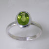 Peridot 2.5 ct Oval Bezel Set Sterling Silver Ring, Size 7.5