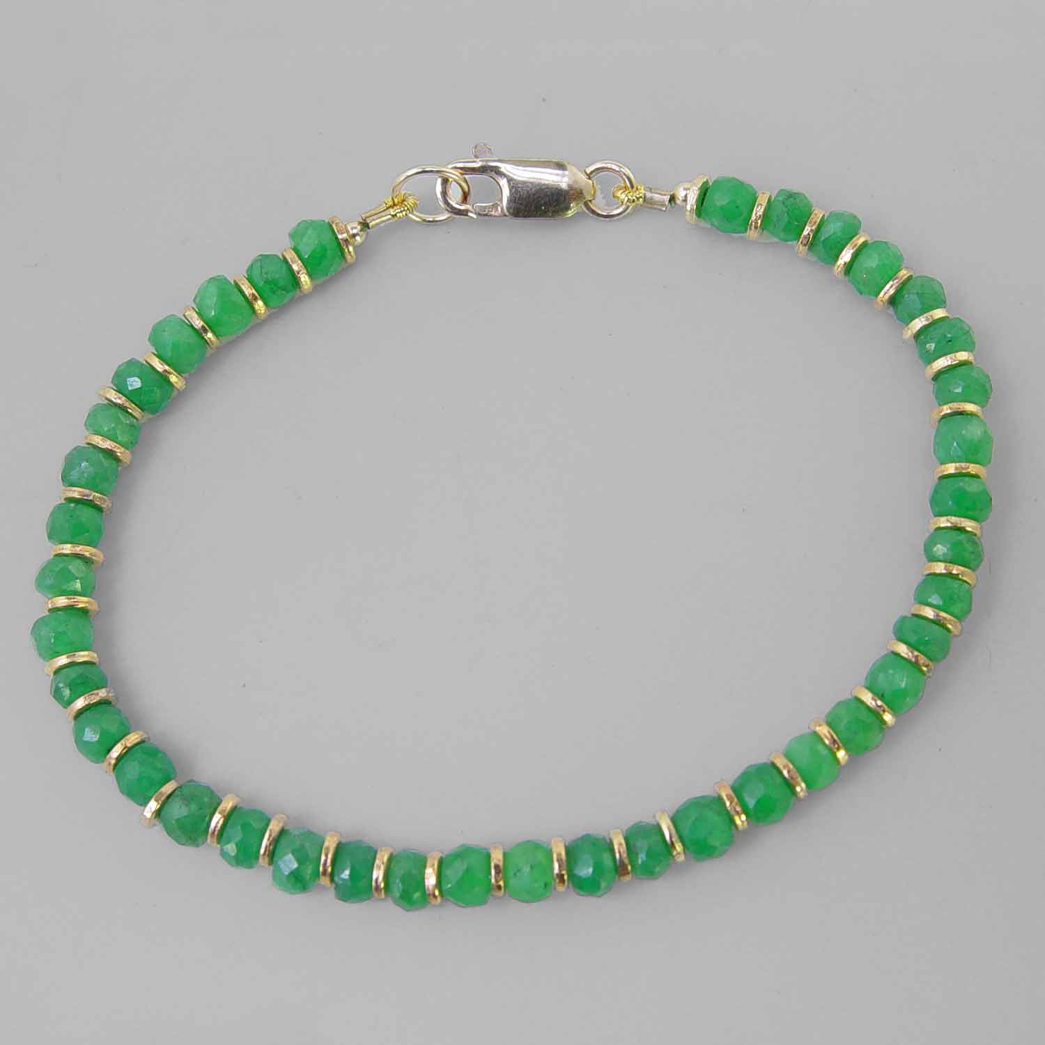 Emerald Faceted Rondelle With Gold Accents Bracelet - 25 CTW